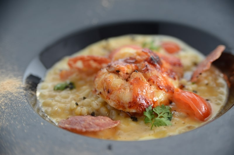 Barley Risotto with Garlic Cream, Sautéed Lobster Tail, Crispy Salami Nostrano & Black Lava salt